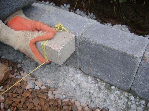 Finish block paving 60mm below kerb