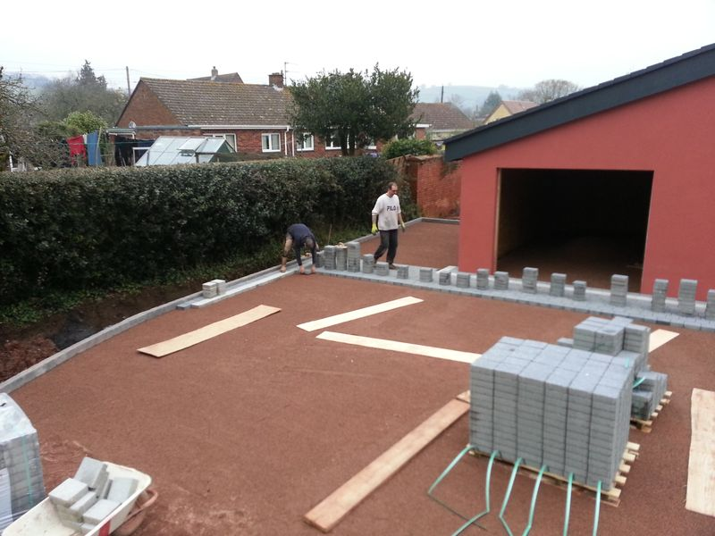 Laying permeable block paving