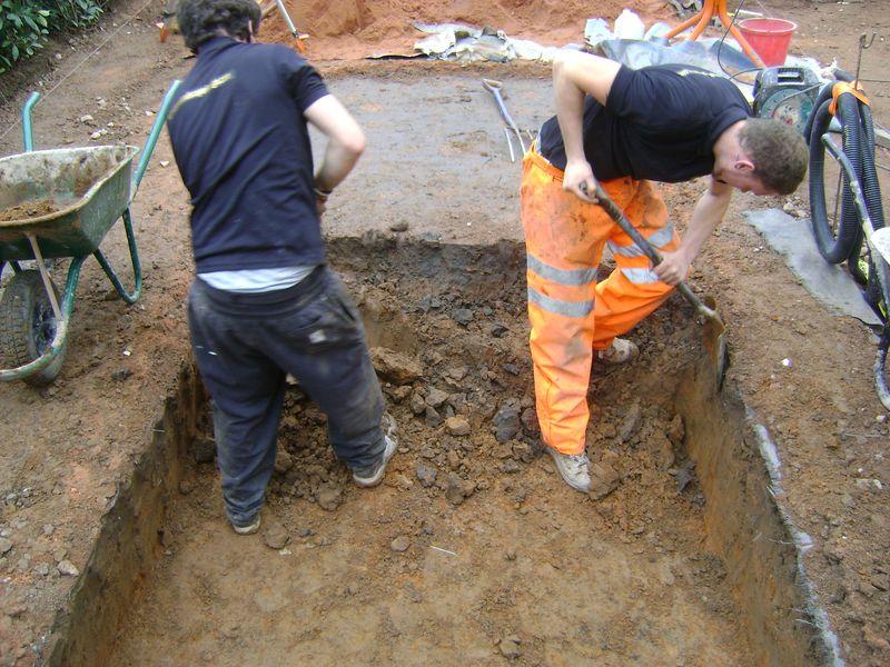 Hand excavation to garden pond
